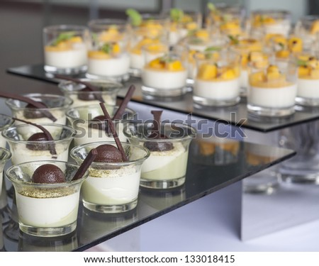 Many delicious desserts at restaurant buffet - stock photo