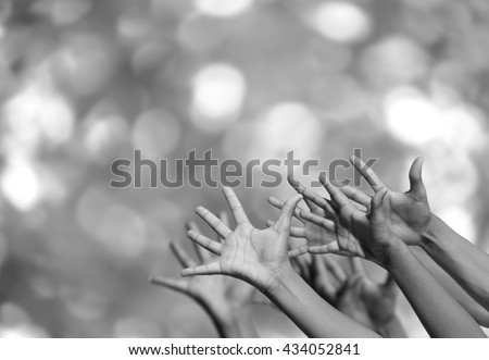 Many desperate arms reaching for a helping hand - stock photo