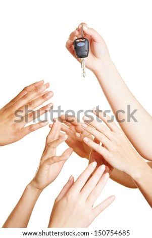 Many desperate hands reaching for car keys - stock photo