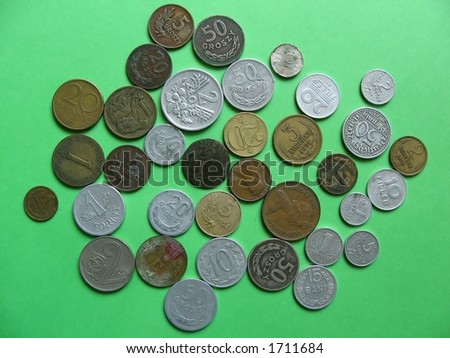 many difference old coins on green background... obverse side Polish,German,Hungarian,Austrian,Czech&Slovakia,Russian(CCCP),Dutch coins - stock photo
