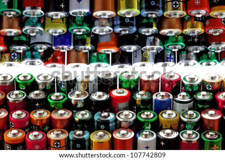 Many different aa batteries, background