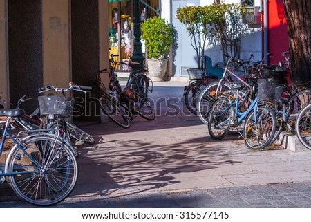 many different bikes parked - stock photo