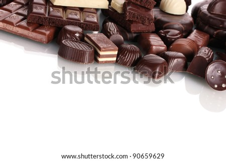 Many different chocolate candy isolated on white