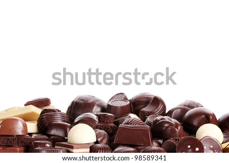 Many different chocolate candy isolated on white - stock photo