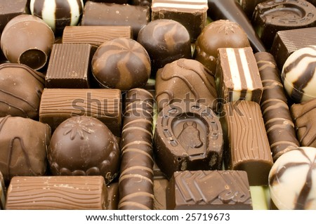 Many different chocolate sweets as a background