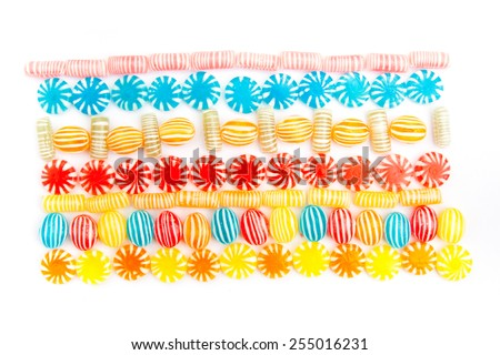 many different color candies, background - stock photo