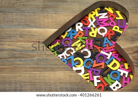 Many Different Color English Letters Or Alphabet In Heart Shape Made Of Wood, Copy Space, Background, Close Up - stock photo