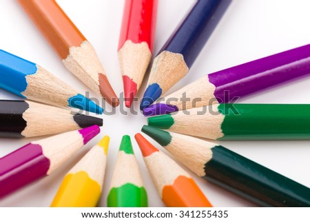 Many different colored pencils on white background. - stock photo