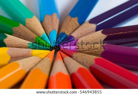 Many different colored pencils put in circle on a white background. Colored pencils rainbow.