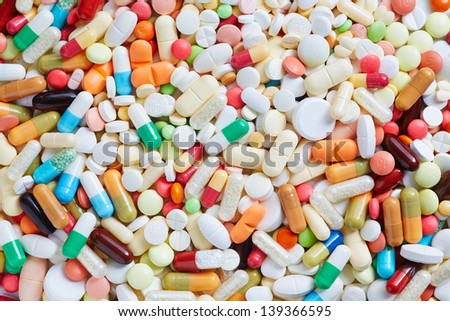 Many different colorful medication and pills from above - stock photo