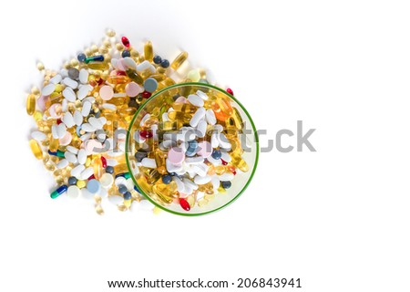 Many different colorful medication and pills from above on white background with copy space - stock photo