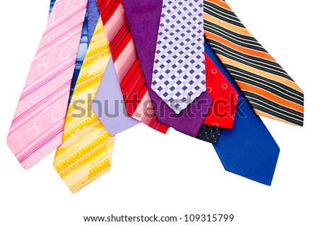 many different colorful ties, isolated over white - stock photo