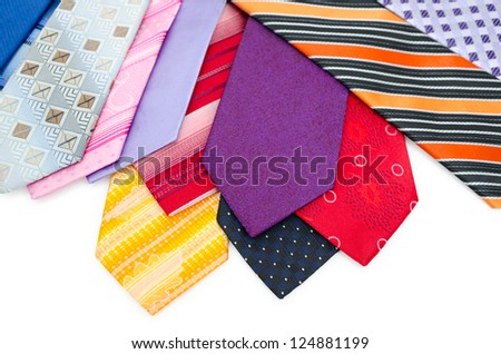 many different colurful mens ties, over white - stock photo