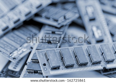 Many different computer memory modules in blue (RAM, SD, DDR, EPROM) - stock photo