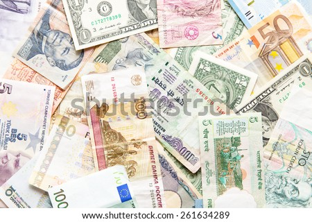 many different currencies as colorful background concept global money - stock photo