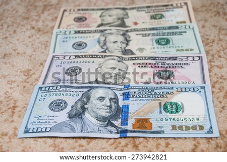 Many different dollars banknotes as background - stock photo