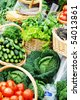 many different ecological vegetables on market table - stock photo
