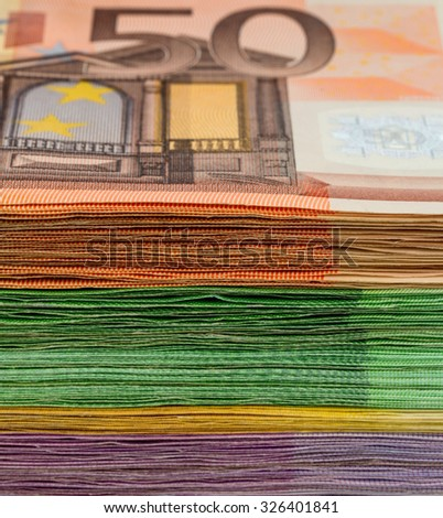 many different euro bills. photo icon for wealth and investment - stock photo