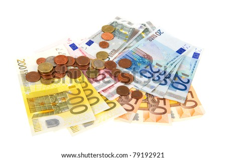 Many different European banknotes and coins on white background