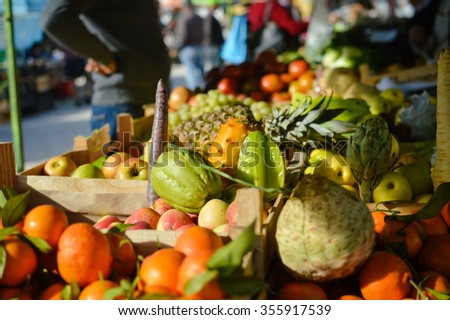 Many different fruits on  farmers market background  - stock photo