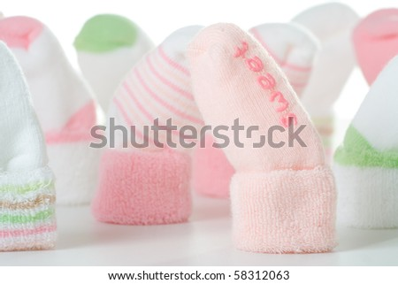 Many different green and pink socks for baby. - stock photo