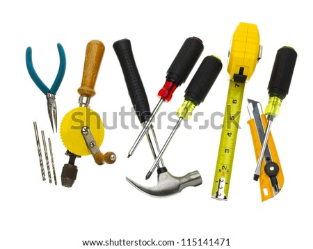 Many different hand tools placed on a white background