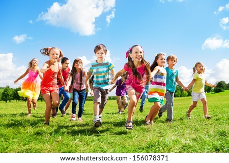 Many different kids, boys and girls running in the park on sunny summer day in casual clothes - stock photo