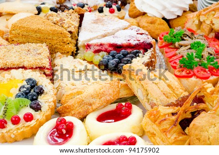 many different kinds of dessert - cakes, sweets and pies - stock photo