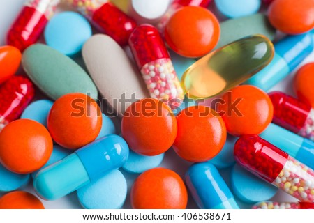 Many different pills in pile. Close up. Concept of medicines. - stock photo