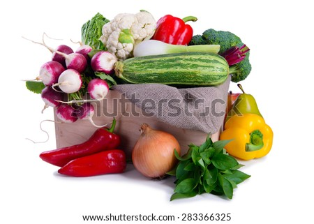 Many different ripe vegetables in box isolated. large depth of field of the frame - stock photo