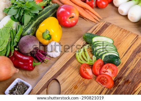 Many different ripe vegetarian vegetables on cutting board close up - stock photo