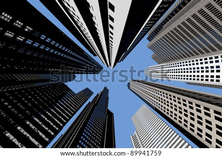 Many different skyscrapers from below with blue sky