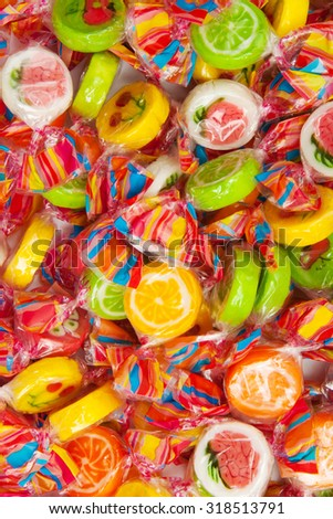 many different tasty candies, pile - stock photo