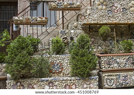 Many different types of shells decorate the front of this house in Rovinj - stock photo