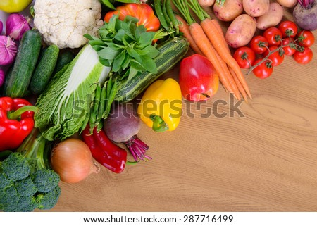 Many different vegetarian vegetables on a wooden board. large depth of field of the frame - stock photo