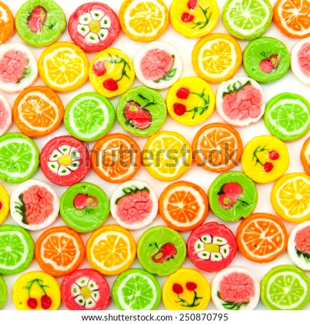 many differnt tasty candies on white - stock photo