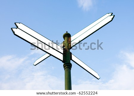 Many direction signs in the sky. To tell the way places. - stock photo