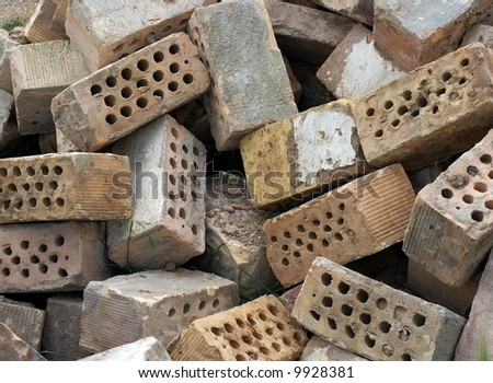 Many dirty bricks in a big pile - stock photo