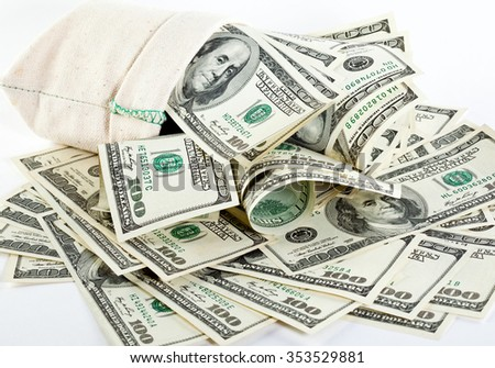Many dollar banknotes in a sack on neutral background; keeping money in a sack
