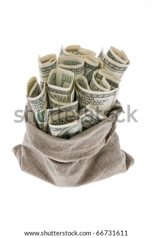 Many dollar bills in a bag. symbopl for taxes - stock photo
