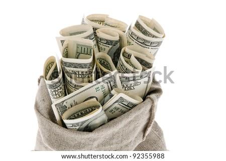 many dollar bills in a sack. white background - stock photo