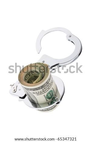 Many dollar bills with handcuffs - stock photo