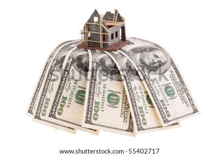 Many dollars bills and shell house - stock photo