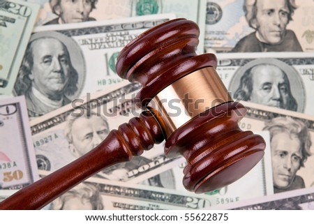 Many dollars bills with gavel. Legal costs - legal fees. - stock photo