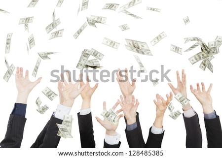 Many dollars falling on business people hand - stock photo