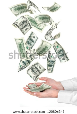Many dollars falling on hand with money - stock photo
