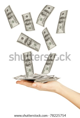 Many dollars falling on womans hand with dollars - stock photo