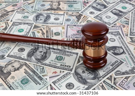 Many dollars of money and a judge hammer - stock photo