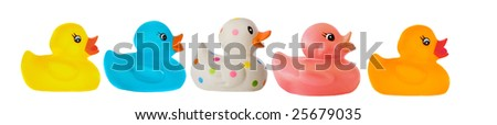 Many ducks toy of different colors on a over white background - stock photo