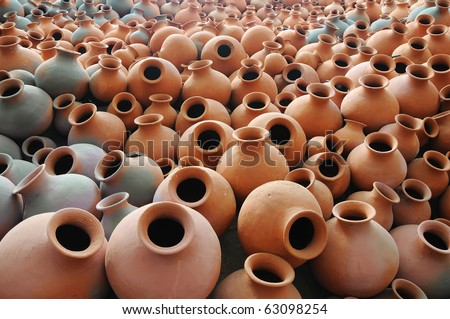 Many earthen pots kept for drying in the sun - stock photo
